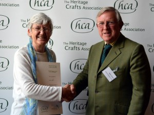 Jean Leader being presented with her award