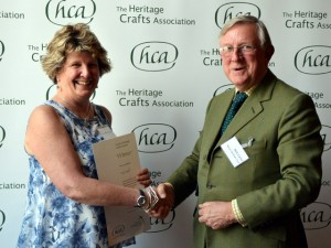Mary English being presented with her award